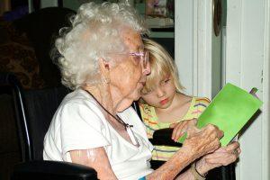 reading-child-gran-wheelchair