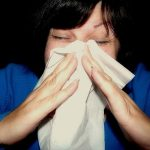 woman-sneeze-into white-hankie